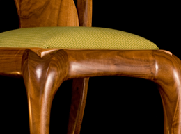 Modern walnut carved chair detail